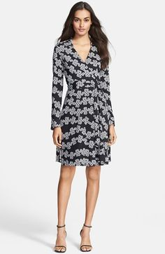 Free shipping and returns on Diane von Furstenberg Print Silk Jersey Wrap Dress at Nordstrom.com. Knotted links garland a sumptuous silk-jersey dress, reinventing Diane von Furstenberg's signature silhouette with bold, graphic appeal. A point collar and button cuffs lend it office-perfect polish.