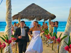 The happy couple walking down the isle at the Breezes Bahamas Resort.