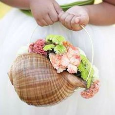 Shell basket for flower girls~ Don't forget seashell personalized napkins! It's all the details! #beachwedding www.napkinsperson...