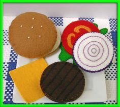 This is an adorable cheeseburger made with 100% natural wool felt. The size is so cute for little hands and fingers, measuring about 2 1/4 inches high when it is stacked. The hamburger patty is just under 2 1/2 inches around, the cheese is 2 1/2 inches square. Each piece has been