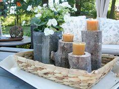 tiered log candlesticks in centerpiece