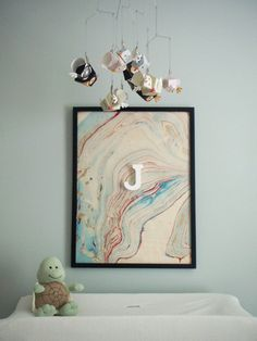 i love this idea of framing marbleized paper...must get my suminagashi inks out sometime soon!