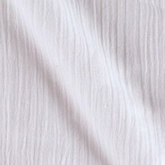 Island Breeze Gauze White from @fabricdotcom  This ultra lightweight, semi-sheer cotton gauze fabric is great for flowing blouses, dresses, bathing suit cover ups, peasant blouses, skirts and even scarves.