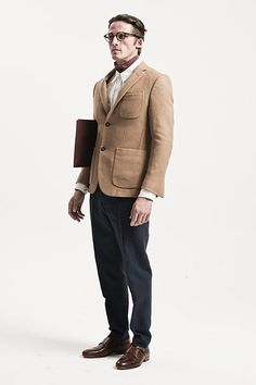 All Ages: Tailoring: Model wears camel jacket with cream shirt and navy trousers
