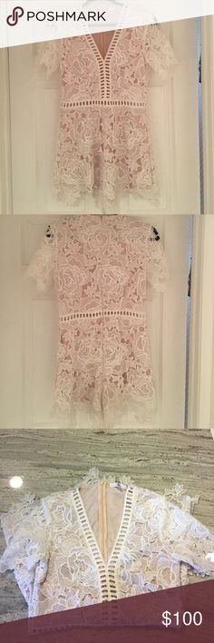 White lace romper Adorable white lace romper. Has nude underlay that is attached on the top to the lace. Lace at waist is open & see thru, then nude shorts fit loosely underneath short area. Bought from another poser, previously worn but still in good condition. 100% polyester. Missguided Shorts