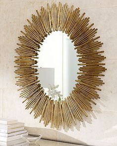 Arteriors Prescott Oval Iron Mirror: Wall mirror in starburst frame creates a stunning look over a sofa or hall console.    Handcrafted of iron with gold leaf finish.    34