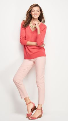 Break out your spring wardrobe with a coral pink v-neck sweater and a statement necklace to match.