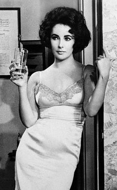 Elizabeth Taylor made a statement in a slip dress in 1961s Butterfield 8. The costume designer for the film was Helen Rose. (Associated Press)