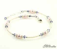 Handcrafted adjustable 9 - 10 inch beaded anklet created with cream charlotte seed beads, light tanzanite Swarovski Austrian crystals, light rose pink Swarovski crystal-based pearls, bright Bali silver, and sterling silver. Beaded Anklets, Beaded Jewelry, Beaded Bracelets, Crystal Beads, Swarovski Crystals, Something Blue Wedding, Pearl Color, Ankle Bracelets, 925 Silver