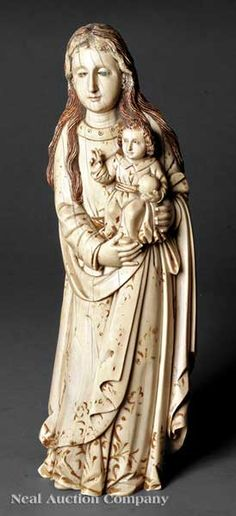 Continental Stained and Gilt Decorated Ivory Figural Group of the Madonna and Child, 19th c.