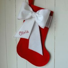 Another way to personalize a stocking...embroider the name on a bow.