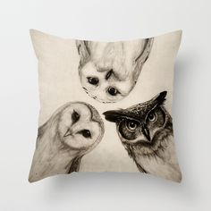Because oh my gosh these guys are cute. :: The Owls 3 Throw Pillow by Isaiah K Stephens