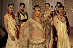 Models display the creations of Indian designer Anju Modi during Delhi Couture Week 2011 in New Delhi, India, Sunday, July 24, 2011