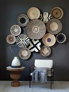 GravityHome does such an amazing job of grouping these African baskets into a calm, serene display! Shop for your own wall baskets at Baskets of Africa: http://www.basketsfromafrica.com/items/wall-decor/list1.htm #interior_decor_art