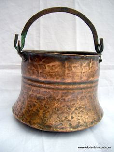 A late 19th century hand made small copper pot complete with handle and was probably the work of Jewish craftsmen in Marrakech.