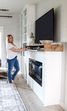 When I started planning our built-ins and DIY fireplace, I knew I wanted a big chunky mantel. Diy Fireplace Mantel, Fireplace Tv Wall, Build A Fireplace, Fireplace Built Ins, Fireplace Remodel, Fireplace Design, Fireplace Makeovers, Simple Fireplace, Fireplace Ideas