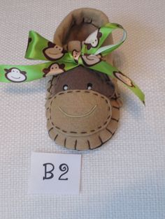 Boy Baby booties in brown with a monkey theme. $20