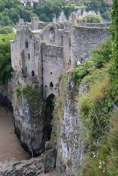 Chepstow Castle atop a cliff across the River Wye which separates England and Wales.