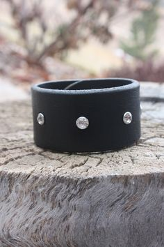 Crystal riveted black leather cuff. #leathercuff #swarovskicrystals