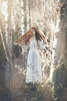 The Enchanted Forest: Female in white dress standing in woods