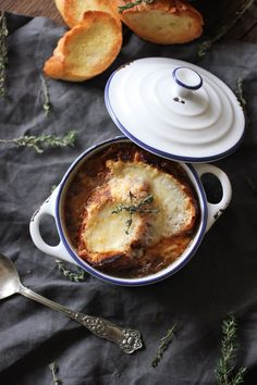 French Onion Soup with a crisp baguette crouton smothered in melty Gruyere cheese.