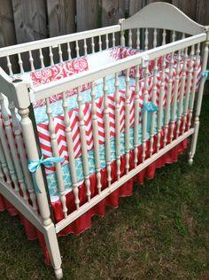 Custom Aqua and Coral Crib Bedding. $320.00, via Etsy.