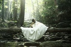 love the woods, the sun,and the flow of her dress.