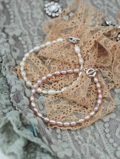 Delicate and dainty freshwater pearls to adorn your wrist, from our Classicscollection! Thesebeautiesare made with freshwater baroque ricepearls available in two styles; white and rose. Bracelets handmade by Annadria Luxe Bijouterie