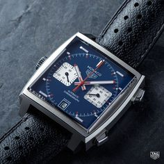 With a black calfskin strap, a unique square dial and the vintage Heuer logo, the TAG Heuer Monaco Calibre 11 is a profoundly stylish timepiece that stands out from the crowd. Simple Watches, Cool Watches, Watches For Men, Men's Watches, Tag Heuer Automatic, Tag Heuer Monaco, Tag Heuer Carrera Calibre, Tag Heuer Formula, Hand Watch