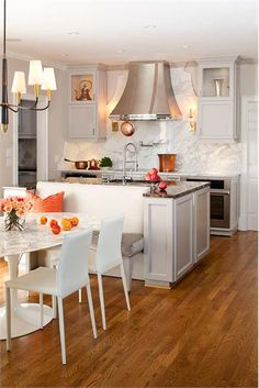 Love the orange accents in this kitchen by TerraCotta Properties