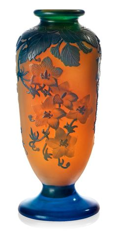❤ - Émile Gallé | Quadrilateral on foot, polished and etched decoration of flowering branches in blue against orange fund. Signed Gallé on life.