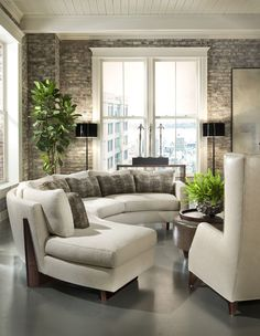 """""""Curved"""" Clip sectional with Rob lounge chair and Clip ottoman from Thayer Coggin furniture."""