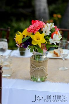 Colorful flowers in mason jars as centerpieces | Jim Kennedy Photographers