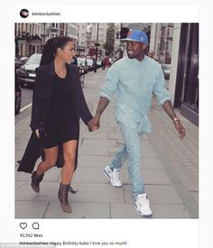 So happy! Kim Kardashian gushed that she loved Kanye West 'so much' on his 40th birthday on Thursday