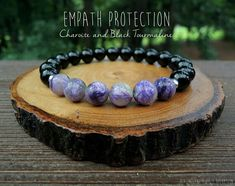Empath Protection Russian Charoite (8mm) and Black Tourmaline (8mm)  This Healing Garden Shop design was created with Russian Charoite and Black Tourmaline with the intention to help protect the aura and protect from negative energies. This was made specifically with the Empath in mind. All bracelets can be made without spacers for a more unisex style. Please include a note when checking out or you can send me a convo.  Charoite is a grounding stone and helps to cleanse the aura and…