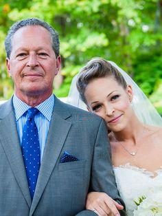Set up a sweet wedding photo pose between the bride and father of the bride to create sentimental photography moments.