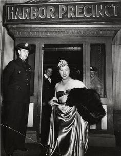 Weegee, Man arrested for cross-dressing, New York, ca. 1939 #vintage #newyork #furs