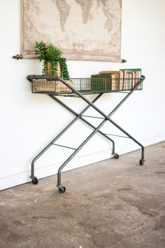 Rolling Metal Basket Console by LesSpectacles on Etsy https://www.etsy.com/listing/266128150/rolling-metal-basket-console