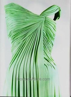 April, 1962...Jackie had just returned from a vacation in Palm Beach and was deeply tanned.  She was luminous in green draped silk jersey by Oleg Cassini., for the reception for the Nobel Laureates