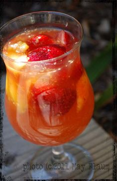 peach sangria | put two peaches in blender and puree along with approximately 3 tbsp sugar and 3 tbsp hot water. pour bottle of wine and puree into pitcher then add about ½ cup peach schnapps and 2 more peaches chopped up and dumped in 1 orange in segments (squeezed a bit as dropped in) 8 strawberries quartered optionally add triple sec liquor, pineapple juice, orange juice, apple slices, other berries. chill in fridge and enjoy with or without ice.