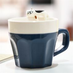 These cute hand cat painted mugs are purrr-fect! They come in all your favourite colours and each one is hand painted to give a unique adorable face.