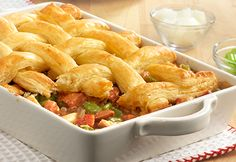 Cajun pot pie  All the flavors of Cajun-inspired jambalaya can be found in this hearty, kickin' pot pie. Turkey, andouille sausage, green peppers, onions and tomatoes are simmered with turkey gravy and Cajun seasoning and spooned into a baking dish, topped with puff pastry and baked until perfectly golden. This is one pot pie that is loaded with flavor everyone will enjoy!