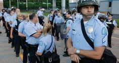 Police disperse defiant Ferguson protesters
