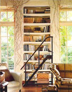floor to ceiling bookshelf between floor to ceiling windows ...  awesome!