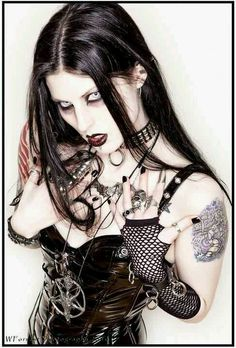 #Goth girl in a witch, traditional and fetish mesh-up outfit.
