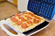 Cook pizza in a waffle iron. Roll out dough and place on a hot waffle iron. Cook closed for 2-3 min. Top with sauce, cheese and toppings. Cook with lid open until cheese is melted.
