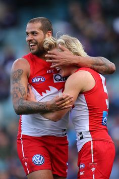Lance Franklin of the Swans congratulates Isaac Heeney after kicking a goal during the round 19 AFL match between the Fremantle Dockers and the Sydney Swans at Domain Stadium on July 31, 2016 in Perth, Australia.