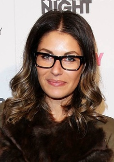 Camilla Freedman. Black statement frames for a round face.