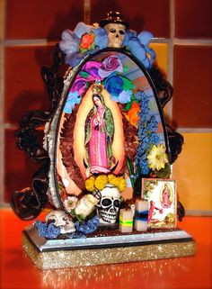 Day of the Dead shrine crafted from a canned ham tin, with a Dover clip of Our Lady of Guadalupe. Tristan Robin Blakeman