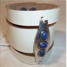 Free people leather cuff bracelet with blue stones Brand-new with tags attached 100% leather white with silver adornment  and blue stones 20% off when you purchase more than 1 item from my closet  trades... Perfect for a festival or Coachella✌ Free People Jewelry Bracelets